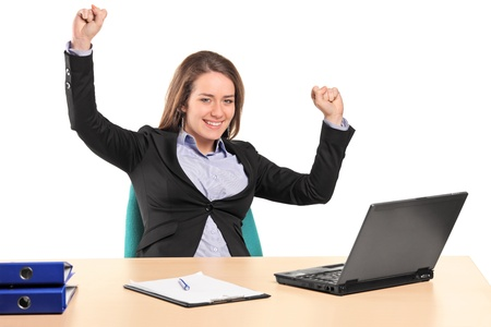 excited: A young happy businesswoman in her office isolated on white background