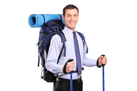 trekking pole: Portrait of a businessman in a suit with backpack and hiking poles isolated on white background