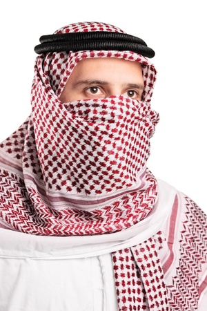 face covered: Portrait of a young Arab wearing a turban isolated on white background