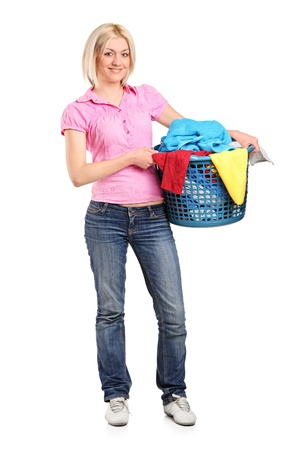 A full length portrait of a young woman carrying a full laundry basket isolated on white background Stock Photo - 9350069