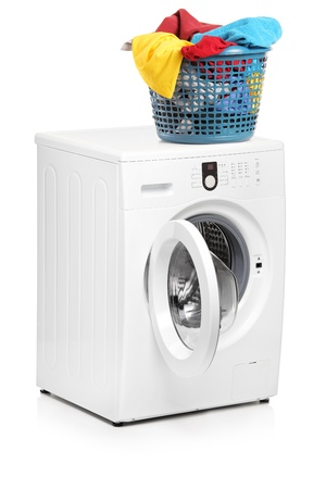 machine: A studio shot of a laundry basket on a washing machine isolated on white background