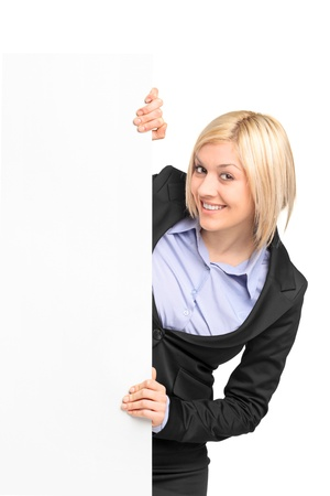 A young blond businesswoman posing behind white banner isolated on white background Stock Photo - 9350076