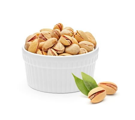Salted and roasted pistachio nuts isolated on white background photo