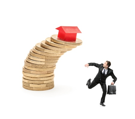 risky job: Scared investor running away from falling real estate prices isolated on white background