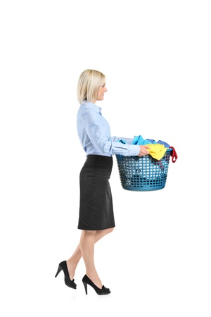 Full length portrait of a young woman carrying a laundry basket isolated on white background Stock Photo - 9405339