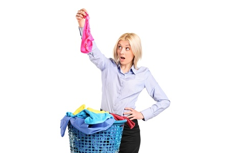 Shocked woman found someone elses panties while laundering isolated on white background photo