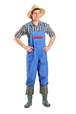 dungarees: Full length portrait of a farmer posing isolated on white background