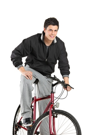A young boy posing on a bike isolated on white background photo