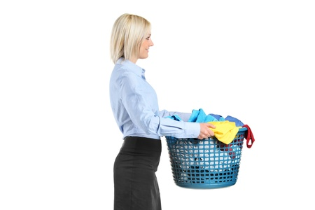 Young woman carrying a laundry basket isolated on white background Stock Photo - 9559711