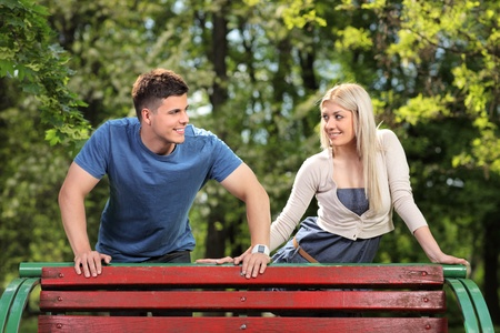 A man and woman in love looking each other in the city park, Skopje, Macedonia Stock Photo - 9605421