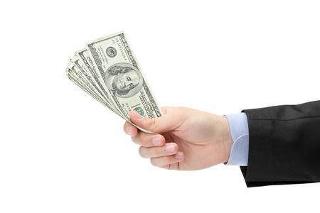 Hand holding US dollars isolated against white background Stock Photo - 9605081