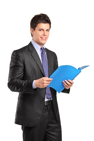 fascicule: A portrait of a smiling businessman holding a fascicule with documents isolated on white background