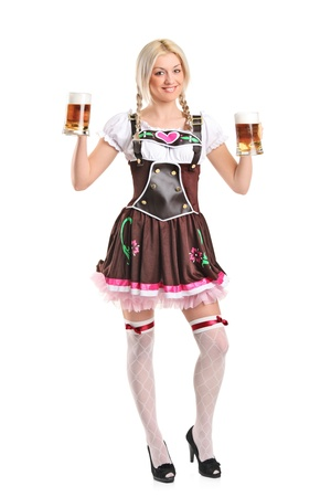 party outfit: Full length portrait of a blond woman with traditional costume holding beer glasses isolated on white background