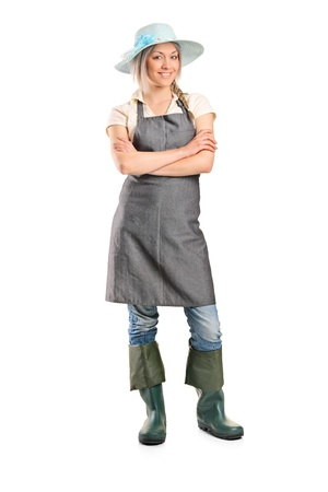 Full length portrait of a female manual worker posing isolated on white background photo