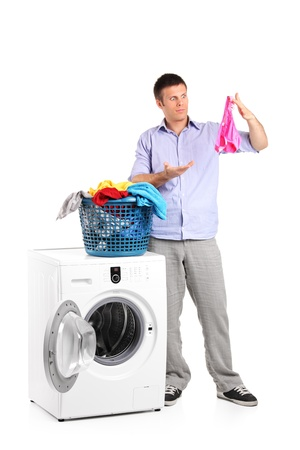 Surprised man found someone elses panties while laundering isolated on white background photo