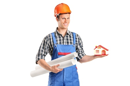 A male construction worker holding a model of house and blueprints isolated on white background Stock Photo - 9655705