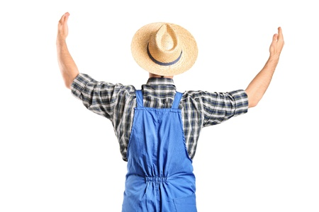 A male farmer gesturing with raised hands isolated on white background Stock Photo - 9655733