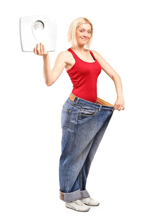 weight loss man: Full length portrait of a weight loss female holding a weight scale isolated on white background