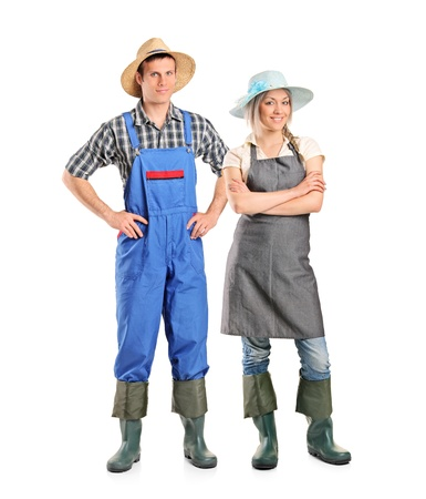 Full length portrait of two farmer posing isolated against white background photo