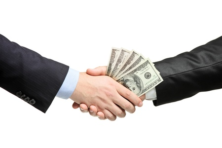 corruptible: Handshake with money isolated on white background Stock Photo