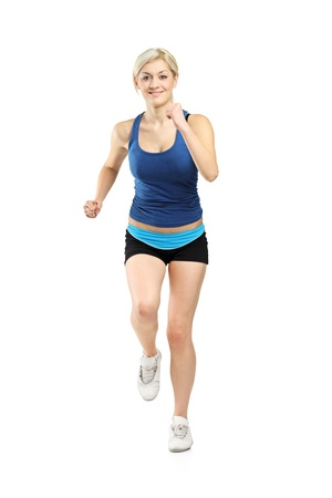 Full length portrait of a female runner isolated on white background photo