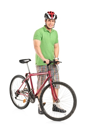Full length portrait of a smiling man posing with a mountain bike isolated on white background photo