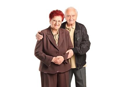 Glimlachend hoger paar poseren geïsoleerd tegen een witte achtergrond Stockfoto