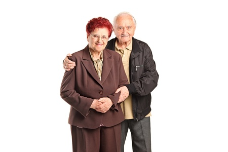 Smiling senior couple posing isolated against white background