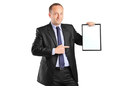 Young smiling businessperson pointing to a blank clipboard isolated on white background photo