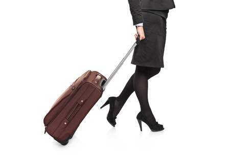 Businesswoman carrying a luggage isolated on white background photo
