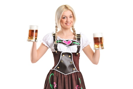 bier glazen: Portrait of a blond woman with traditional costume holding beer glasses isolated on white background