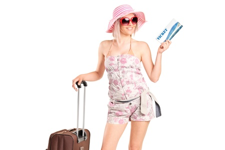 Portrait of a tourist girl holding a ticket and luggage isolated on white background photo