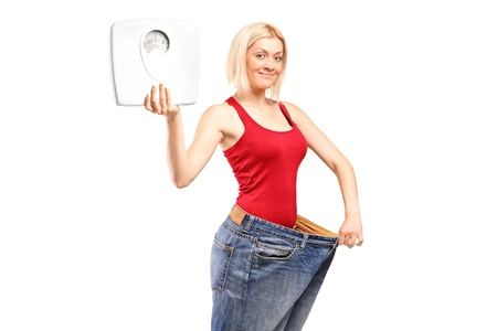 Portrait of a weight loss female holding a weight scale isolated on white background photo
