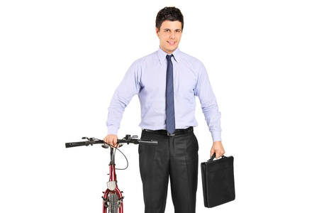 Portrait of a young businessman posing next to a bicycle isolated on white background photo