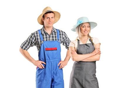 dungarees: Portrait of two farmers posing isolated against white background