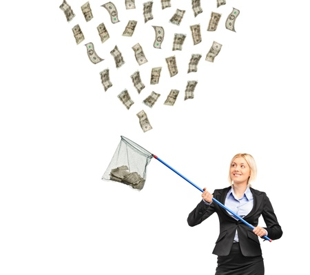 collect: Una empresaria con un neto intentando atrapar dinero aislada sobre fondo blanco Foto de archivo