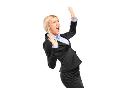 horrified: A scared young businesswoman shouting isolated on white background