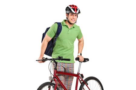 commuter: A young bicyclist posing next to a bicycle isolated on white background