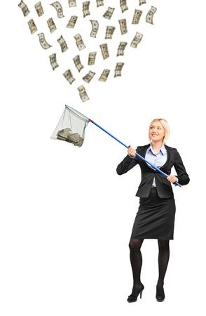 is raining: Full length portrait of a businesswoman with a fishing net trying to catch money isolated on white background Stock Photo