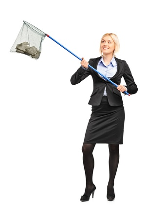Full length portrait of a businesswoman with a fishing net with dollar in it isolated on white background photo