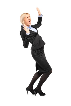 scared woman: Full length portrait of an afraid young businesswoman isolated on white background Stock Photo