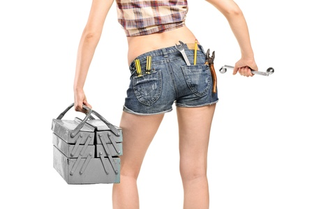 Female worker holding a wrench and tool box isolated on white background photo
