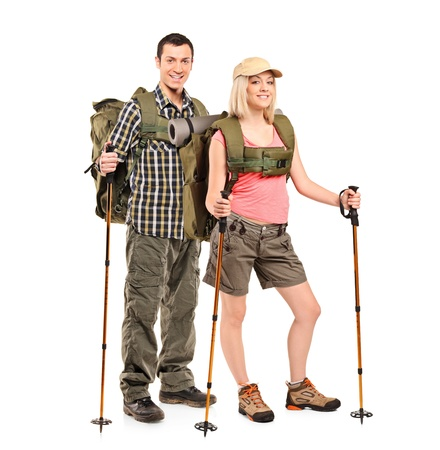 trekking pole: Full length portrait of a man and woman in sportswear with backpacks and hiking poles isolated on white background