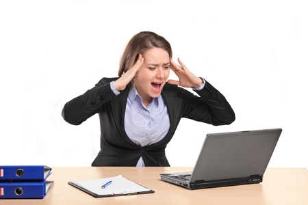 portable failure: A nervous young businesswoman yelling isolated against white background Stock Photo