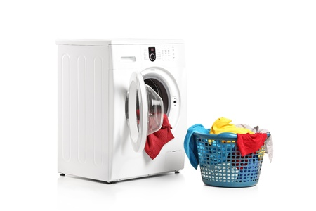 dirty clothes: A washing machine and full laundry bin isolated on white background Stock Photo
