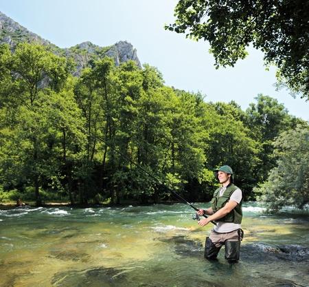 resting rod fishing: A young fisherman fishing on a riverTreska, Macedonia