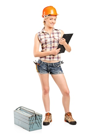 Full length portrait of a female manual worker holding a clipboard isolated on white background photo