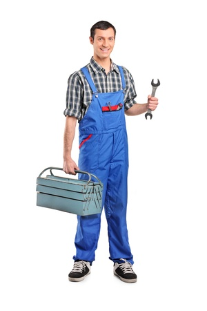 Full length portrait of a male manual worker holding a wrench and tool box isolated on white background Stock Photo - 9825832