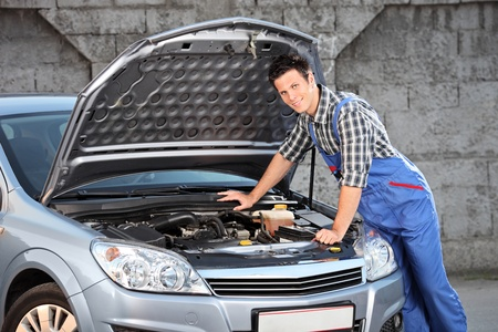 searching for: Young mechanic searching for a car problem Stock Photo