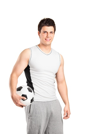 athletic wear: A male athlete holding a football isolated on white background